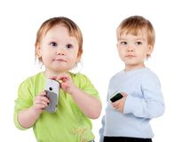 Isolated surprised little girl and boy the phone Royalty Free Stock Photos