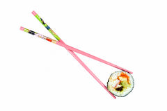 Isolated sushi with pink chopsticks. Isolated sushi roll with pink chopsticks on a white blackground Stock Photos