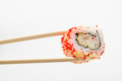 Isolated sushi roll in tempura and chopsticks Stock Images