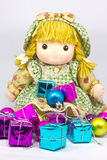 Isolated sweet doll sitting at white background Royalty Free Stock Images