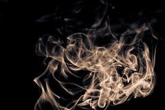 Isolated swirl of incense smoke. Isolated moving swirl of incense smoke on black background Stock Images