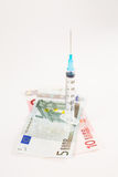 Isolated Syringe and money Royalty Free Stock Photos