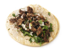 Isolated Taco. Isolated mexican steak taco on a white background Royalty Free Stock Images