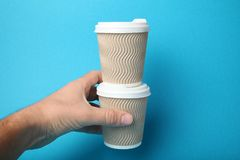 Isolated take away hot coffee, beverage in paper cup royalty free stock photo