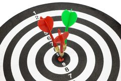 Targets with arrow in the center. Isolated targets with arrow in the center of dartboard on white background royalty free stock image