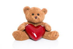 Isolated teddy bear with a red heart Stock Photography