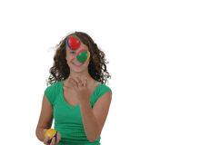 Isolated teenage girl juggling Stock Photos