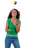 Isolated teenage girl juggling Royalty Free Stock Photography