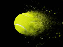 Isolated tennis ball with speed power effect. Isolated tennis ball with abstract speed effect on black background in studio royalty free stock photography