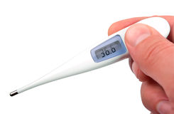 The isolated thermometer in hand. Picture of the electronic thermometer showing temperature of a human body Royalty Free Stock Images