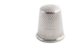 Isolated thimble. Isolated closeup of thimble on a white blackground Stock Images