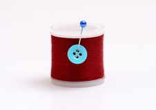 Isolated thread spool with pin on white background Stock Images