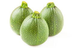 Isolated round courgette on white Stock Images