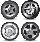 Isolated tire icons. Four different isolated icons of tires Stock Photography