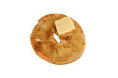 Isolated Toasted bagel with a pat of butter Stock Images
