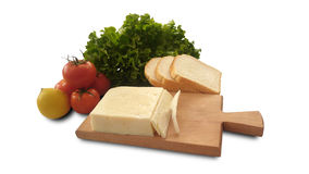 Isolated tomato, lemon, lettuce, bread and cheese royalty free stock image