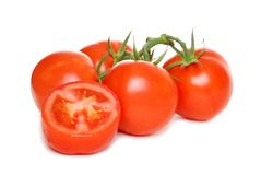 Isolated tomato with one sliced Royalty Free Stock Photography
