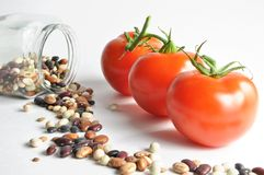 Isolated tomatoes and cooking bean Royalty Free Stock Photo