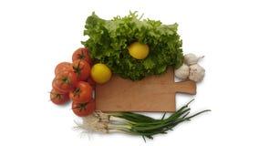 Isolated tomatoes, lemon, lettuce, garlic and fresh salad onion stock photography