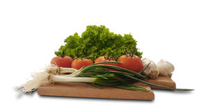 Isolated tomatoes, lettuce, garlic and fresh salad onion royalty free stock images