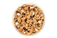 Top view bowl of granola raisin almond cereal. Isolated top view bowl of granola raisin almond cereal royalty free stock photography
