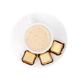 Isolated top view coffee. Cup with chocolate candies in gold foil Stock Image