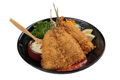 Isolated top view of Fried tempura whiting fish or asohos. Isolated Fried tempura whiting fish or asohos with home made tomato sauce served with sliced cabbage Stock Image