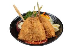 Isolated top view of Fried tempura whiting fish or asohos. Isolated Fried tempura whiting fish or asohos with home made tomato sauce served with sliced cabbage Stock Photo