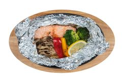Isolated top view of Grilled Salmon in a Foil Pack with broccoli, bell pepper, mushroom and slice lemon. Isolated top view of Grilled Salmon in a Foil Pack with Royalty Free Stock Images