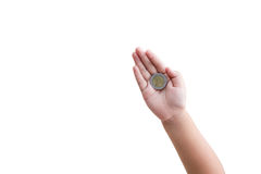 Isolated top view kid hand with coin on white background Royalty Free Stock Photos