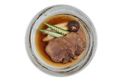 Isolated top view of Streamed beef tounge gyutan served with shiitake, Japanese scallion and chilli with soup. Royalty Free Stock Photo