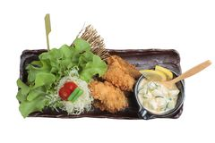 Isolated Top view of Tempura mussel is deep fried mussel mixing with flour served with egg salad. Isolated Top view of Tempura mussel is deep fried mussel Royalty Free Stock Photography