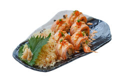 Isolated Torched Salmon Roll with Prawn Tempura Inside.Topping with Cheese, Ebiko Prawn Eggs, Scallion and White Sesame.  Royalty Free Stock Photo