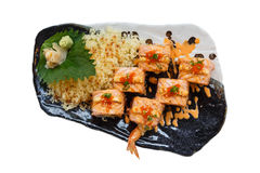 Isolated Torched Salmon Roll with Prawn Tempura Inside.Topping with Cheese, Ebiko Prawn Eggs, Scallion and White Sesame.  Royalty Free Stock Images