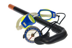 Isolated - Tourist compass, swimming goggles. Tourist compass, swimming goggles, snorkel on the white background royalty free stock image