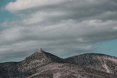 Isolated tower perched on an arid and Mediterranean hill. And cloudy sky in Fenouilledes,  Pyrenees orientales in south of France Royalty Free Stock Image