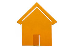 Isolated toy house. Isolated yellow house made of paper Stock Photo