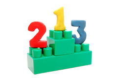 Isolated Toy Pedestal. Green Toy Pedestal Base with Digits on Places Isolated on White Background Stock Image