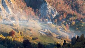 Isolated traditional Romanian houses built somewhere in a valley in Transylvania. Romanian traditional houses built on a valley surrounded by mountains, under a stock images