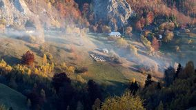 Isolated traditional Romanian houses built somewhere in a valley in Transylvania. Romanian traditional houses built on a valley surrounded by mountains, under a stock photos