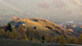Isolated traditional Romanian houses built somewhere in a valley in Transylvania royalty free stock photo