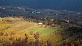 Isolated traditional Romanian houses built somewhere in a valley in Transylvania. Romanian traditional houses built on a valley surrounded by mountains, under a royalty free stock images
