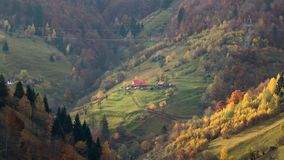 Isolated traditional Romanian houses built somewhere in a valley in Transylvania stock image