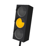 Isolated traffic light with yellow light on Royalty Free Stock Image