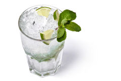 Isolated transparent cocktail with ice 2. A close-up of leaves of mint, ice cubes and slices of lime in a glass of transparent alcohol (mojito) isolated on white Stock Images