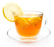 Isolated transparent cup of tea with lemon slice Royalty Free Stock Photos