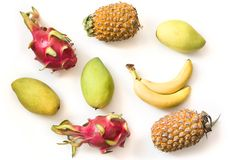 Isolated tropical fruits. Pineapple, banana, pitaya fruit and mango isolated on white background with clipping path. Royalty Free Stock Photo
