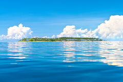 Isolated tropical island in the sea Stock Images