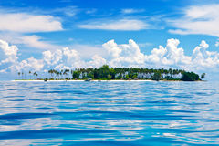 Isolated tropical island in the sea Stock Photo