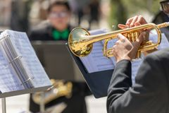 Isolated trumpet player in band. Standing in front of music stand Stock Image